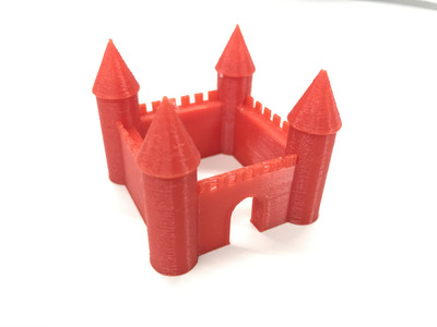 A more Disney-fied castle: conical spires and an archway.