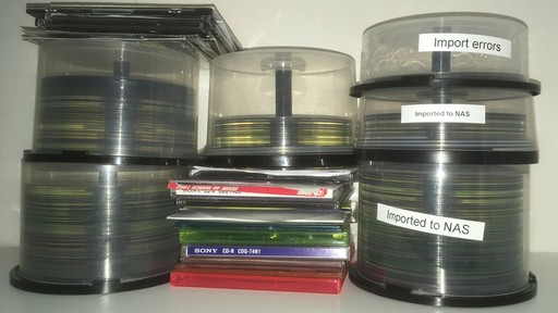 a pile of CDs and DVDs